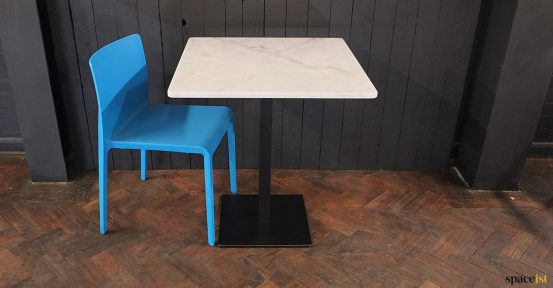 MArble table blue chair