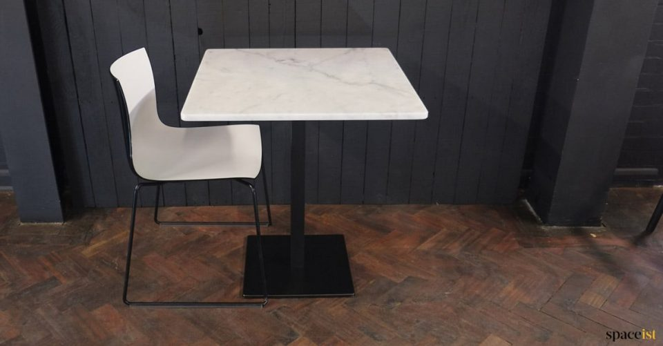 Marble table + white and black chair