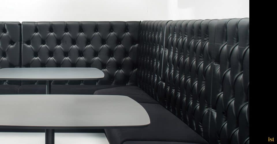 black button style banquette seating