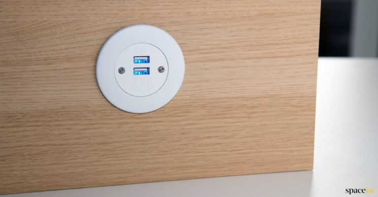 White round USB socket in panel