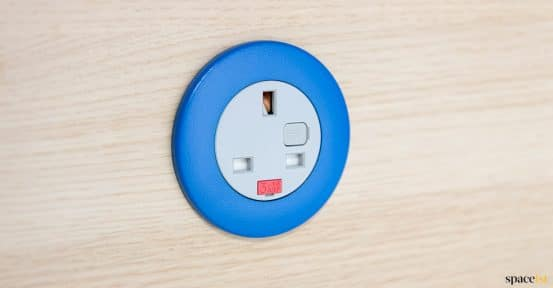 Blue UK plug socket in screen