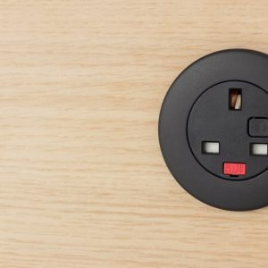 Black Plug socket in oak panel
