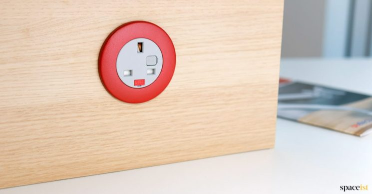 red plug socket in desk screen