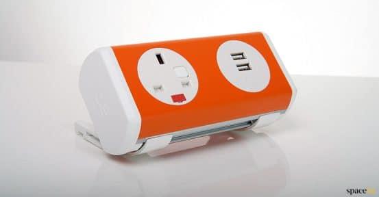 Orange + white UK plug socket for desk