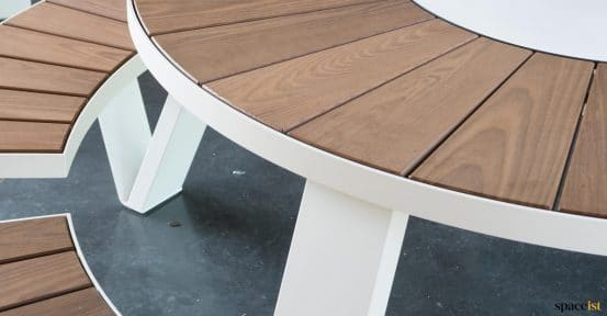 Outdoor wood table closeup - Pentagale