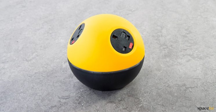 Yellow + black round USB charger