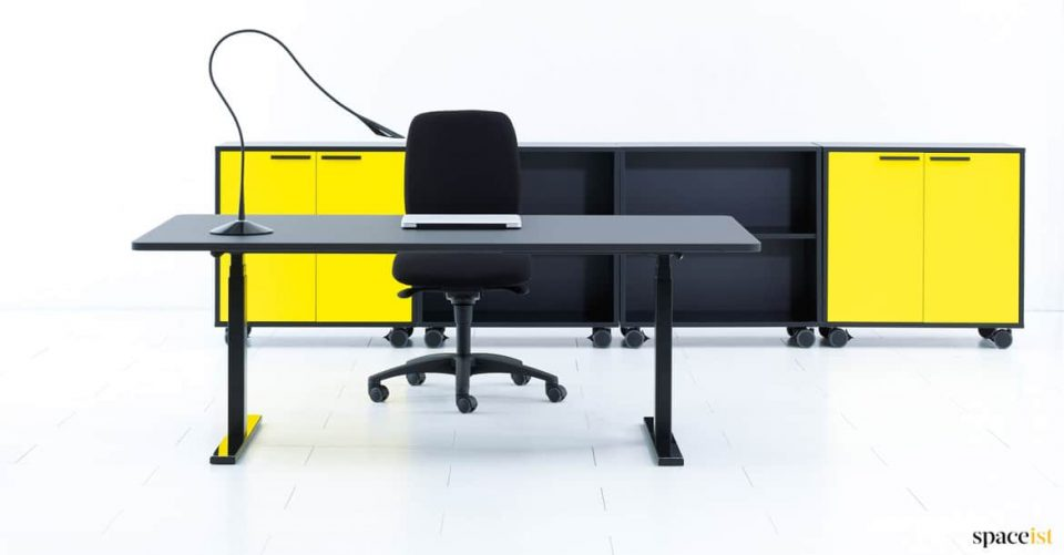 Q20 height adjustable desk with yellow storage