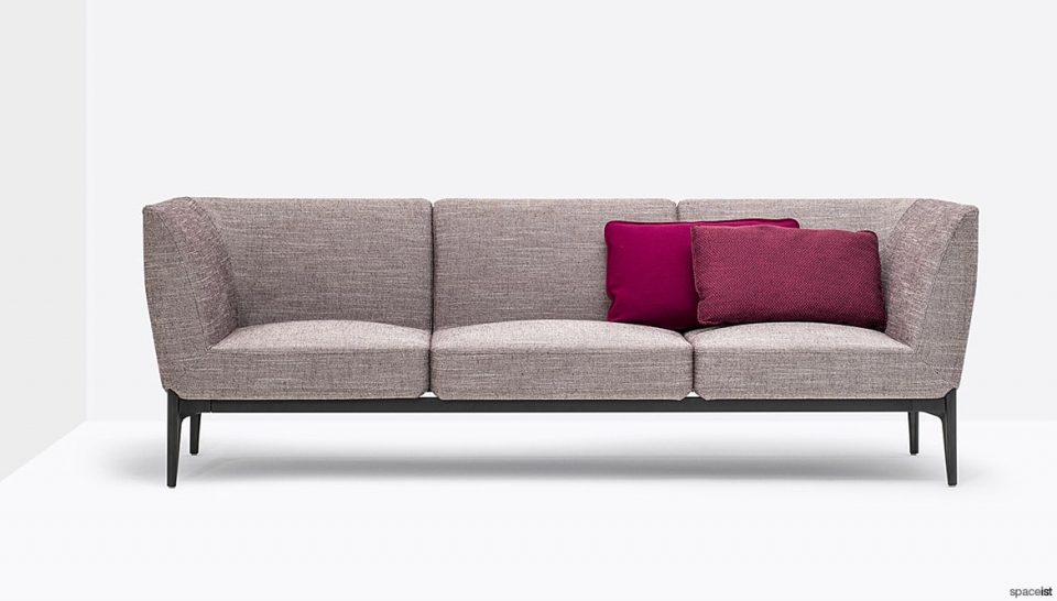 Sofa with pink cushions