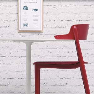 White cafe table red chair