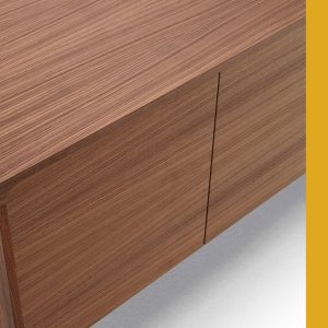 Tactile walnut meeting room cabinet close-up