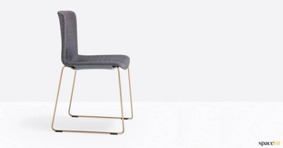 Chair with brass legs