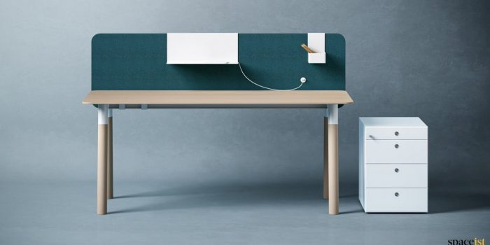 Woods office desk with green dividing screen in fabric