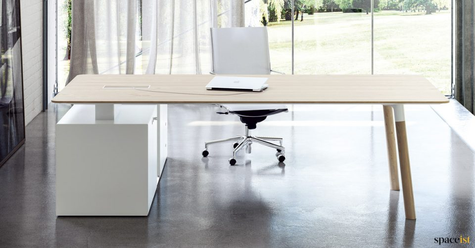 Woods L-shaped executive desk with wood legs