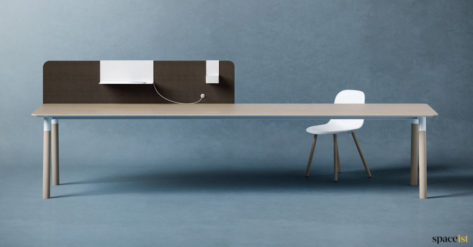 Woods very long office desk to seat three people