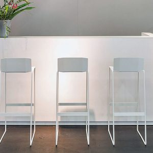 White reception desk with stools