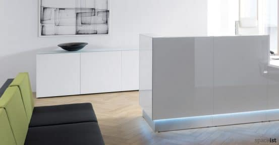 Valde low white glass reception storage