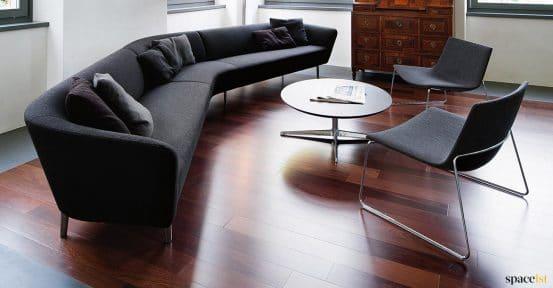 Dark grey sofa on dark wood floor