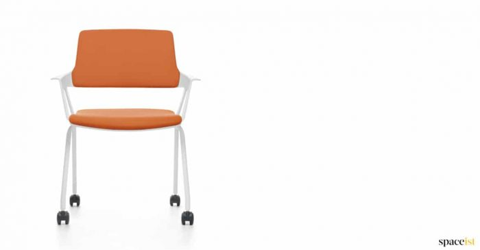 orange chair with castors