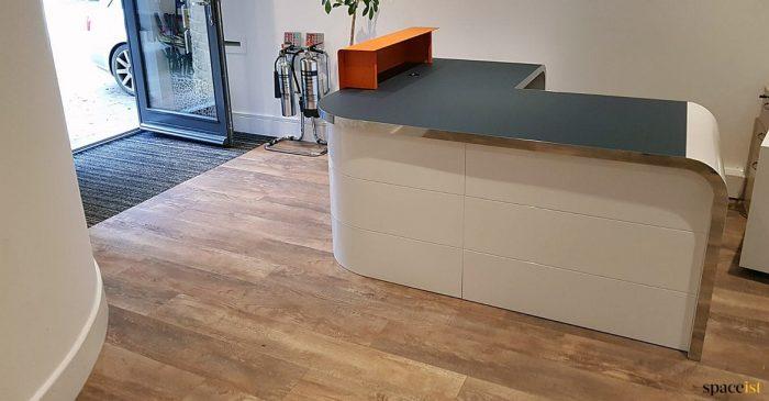Small corner reception desk