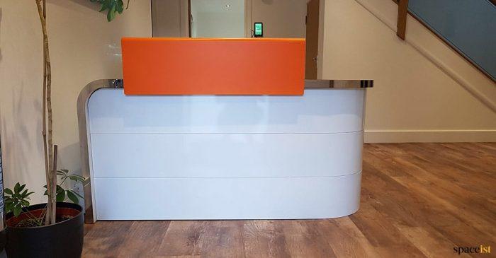 Corner reception desk orange top