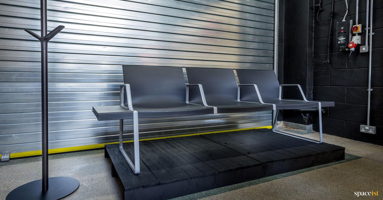 spaceist showroom black bench seats
