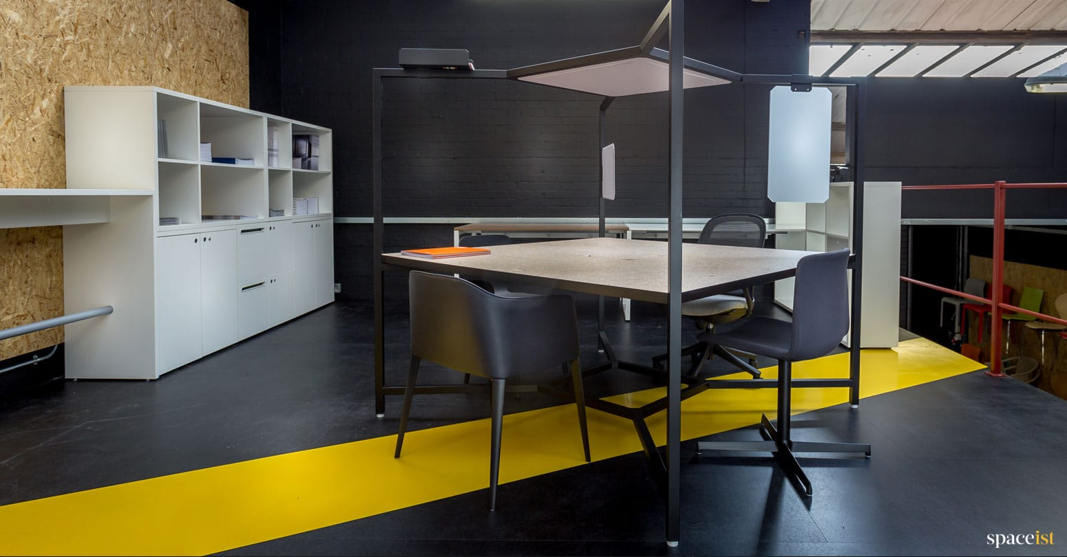 Spaceist furniture showroom black Hub desk