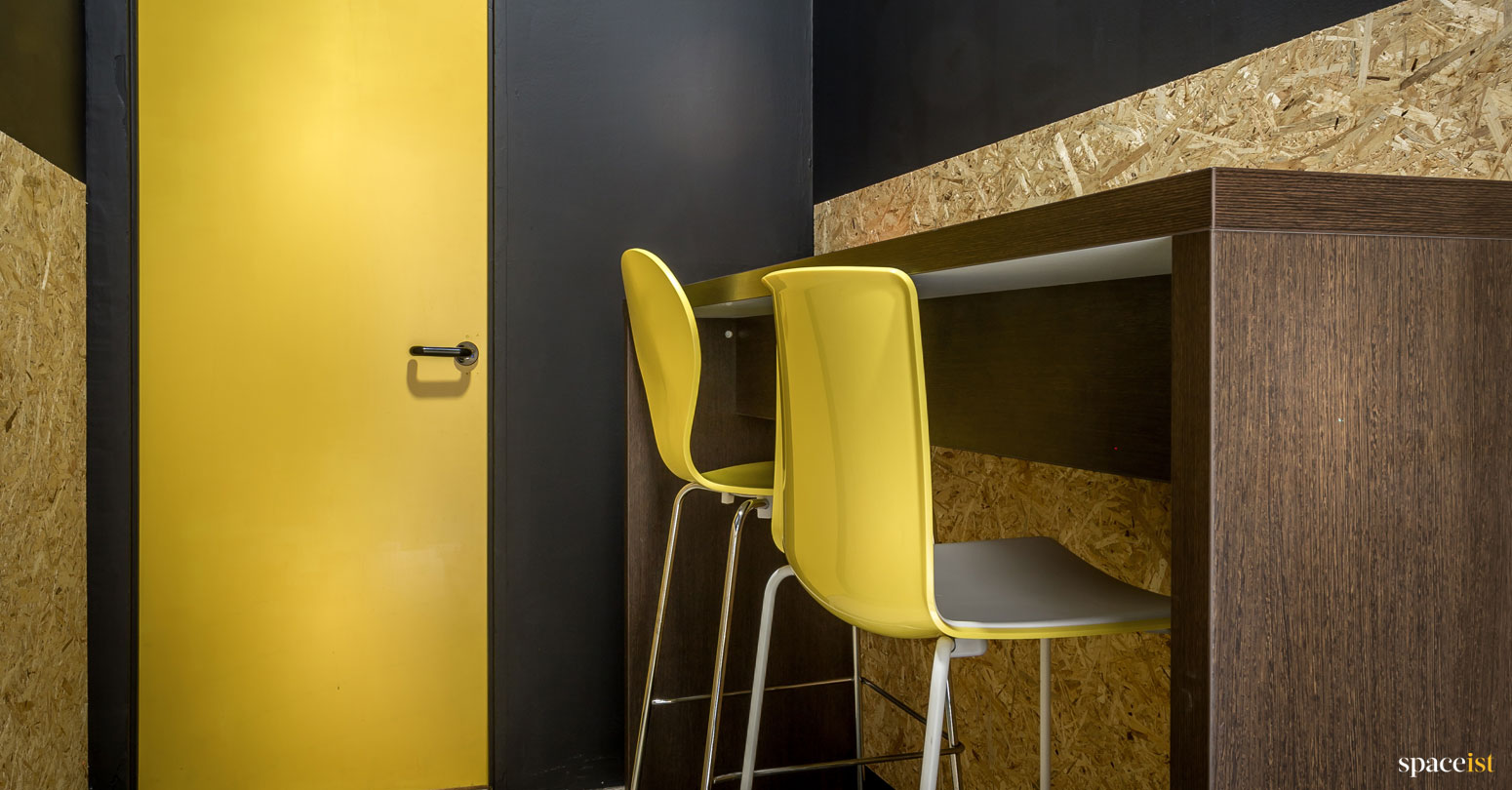 spaceist showroom yellow bar stools