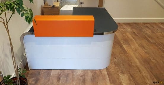 Small corner reception desk