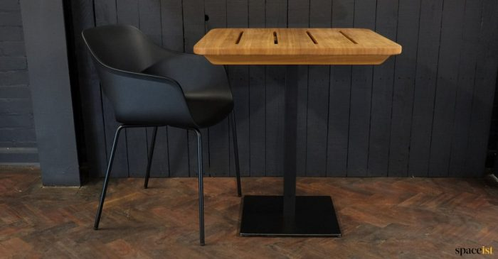 Teak table with black chair