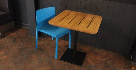 Solid top with blue chair