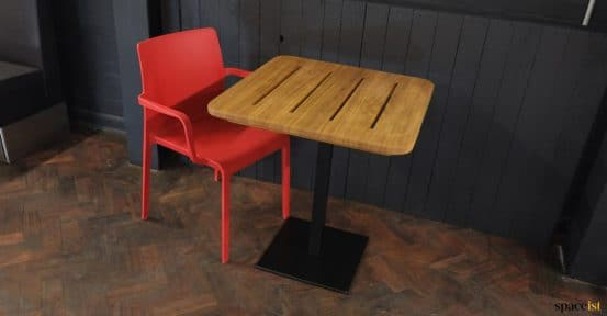 Wood top with red chair