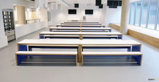 Long white blue tables + benches