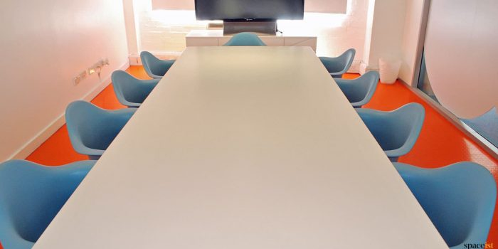 Long white meeting table eames chairs