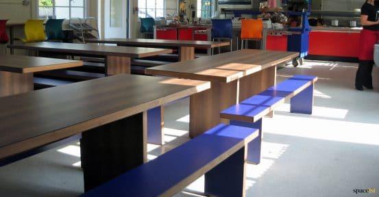 Blue + dark wood dining hall tables