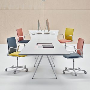 What are the benefits of larger desks for sharing?