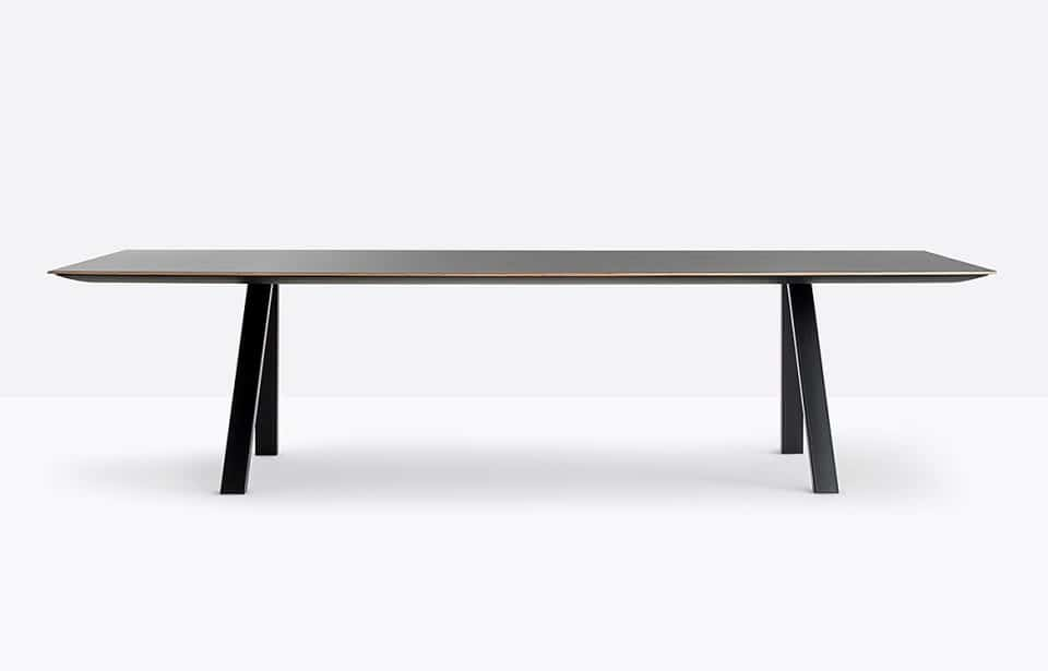 Black conference table with plywood edge