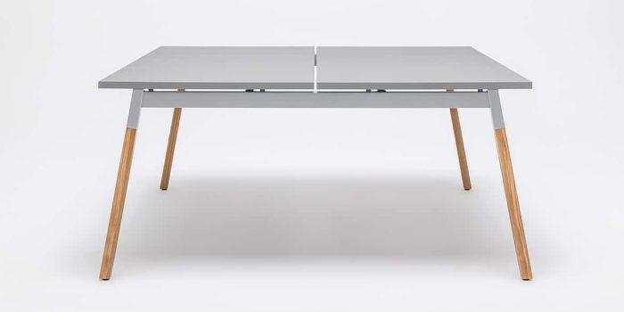Grey desk with wood legs