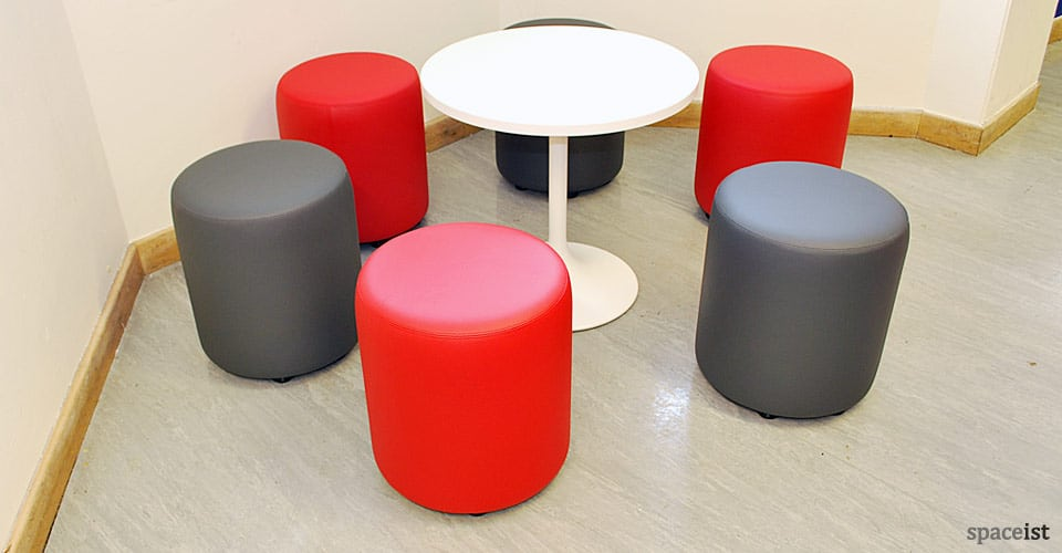 spaceist immanuel college round red stools