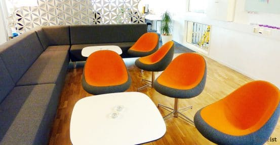 media orange fabric reception chairs