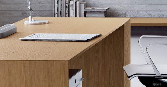 CEO cedar wood desk closeup