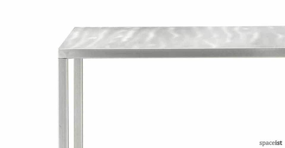 Naked metal square cafe table in clear lacquer
