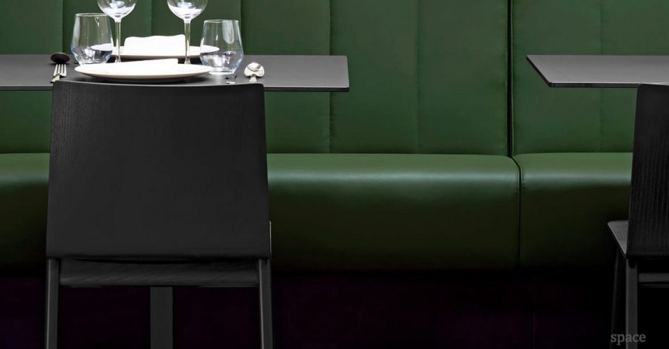 Saka wood chairs in a black close-up