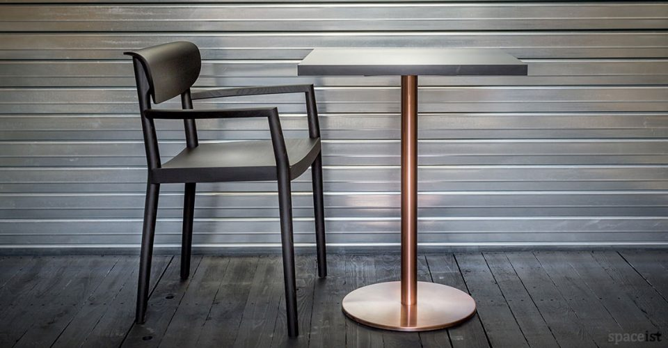 black wood chair with copper cafe table