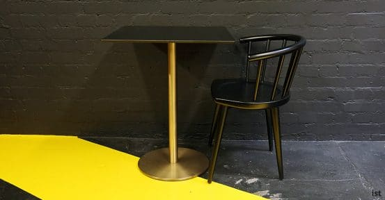 W black cafe chair with brass table