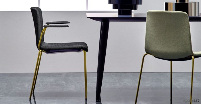 Weet meeting chair with a brass frame and dark grey seat