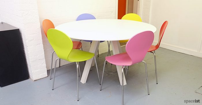 ark round white meeting tables colourful chairs