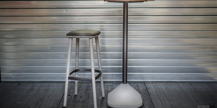 Babila wood bar stool with a metal foot plate