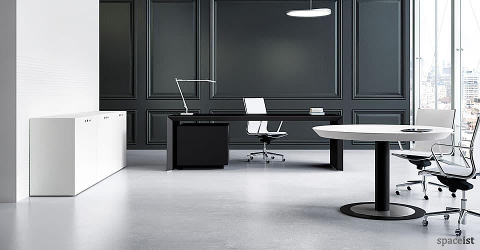CEO black executive office desk