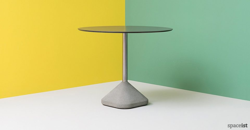 Concrete cafe table with a black round top