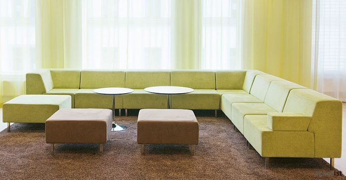 green modular sofa with round coffee tables